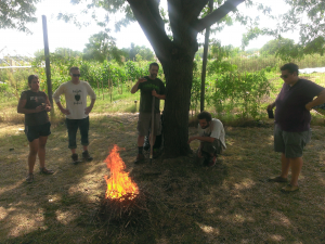 Dale Hendricks demonstrates the open pit method of biochar making