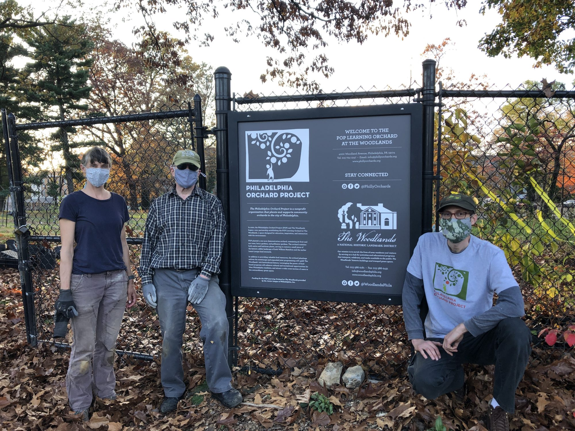 Woodlands Facilities & Landscape Manager Robin Rick, volunteer Joe Shapiro, and POP Co-Director Phil Forsyth at the new sign installed at the POP Learning Orchard entrance in November 2020.